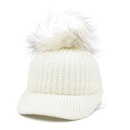 b694f3e4a624ec 2017 Raccoon Fur Pom Poms Baseball Hat Cap Women Wool Knitted pompom Solid  Bobble Hat Warm Thick Hats for Winter Gorras