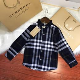 o chemises Promotion 2018 automne et hiver, la dernière chemise à carreaux  classique pour enfants 8a06fed48d9