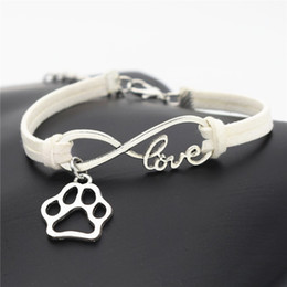 bracelet dog pendants Promo Codes - Infinity Love Pet Footprint Cats Dogs Paw Claw Pendant Charm Bracelets White Leather Suede Rope Cuff Jewelry DIY Handmade for Women Men Gift