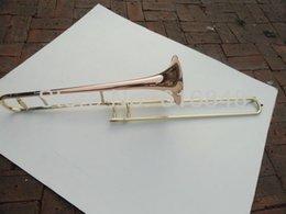 trombón Rebajas Tubo de cobre de fósforo de alta calidad Laca de oro Superficie Eb Ajustable Alto Trombone Reproducir instrumentos de música con estuche