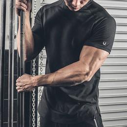 Argentina Muscle brothers verano camiseta de deportes casual de color sólido de secado rápido Corredor para hombres gimnasio de manga corta sudoración top de fitness Suministro