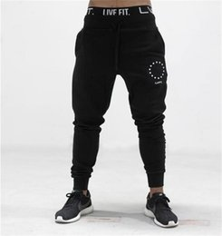Wholesale muscles men pants - Muscle fitness brothers sports casual cotton trousers male breathable Slim beam feet guard pants
