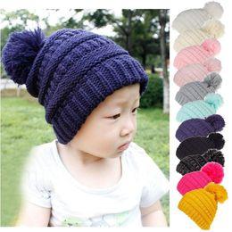 Casquillo recién nacido del color sólido online-11 colores Pom Winter Hat Kids Ball Pom Pom sombreros recién nacido de punto Cap Crochet Solid niños gorros fiesta sombreros CCA10743 20 unids
