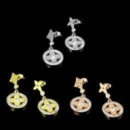 c6fb8d96ac06 Elegante ronda de cuatro hojas de concha de flores pendientes encantadores  con diamantes de acero inoxidable plata rosa de oro con trébol para mujeres  y ...