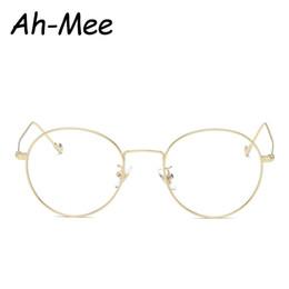 2019 marcos de gafas unisex de metal redondo Ah-mee Marcos ovalados pequeños de los vidrios del empollón Lente transparente Unisex Marco de metal redondo dorado Miopía Gafas ópticas marcos de gafas unisex de metal redondo baratos