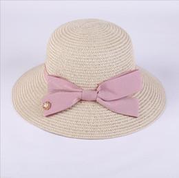 2018 nuevas perlas Sun Hat Big Bow sombreros de verano para mujeres plegable  playa de paja Panamá visera de sombrero ancho Femme Femenino perlas de  sombrero ... 1a5c235cb44