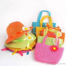 Wholesale wholesale crocheted hats - 2018 Lovely Sunflower Flower cap Children sunhat baby girls Casual Beach Sun Straw Hat+Straw Handbag 2pcs set for kids 9 colors C1938