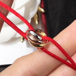 2019 glückliches seil armband Berühmter Markenname Hochwertiges Armband mit glücklichen drei Ringen verbinden Anhänger und Seil für Frauen und Mannschmucksachegeschenk freies Verschiffen P günstig glückliches seil armband