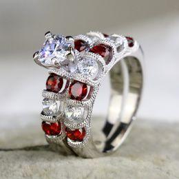 Anillo de bodas de lujo Anillo de plata Corte de corazón Circón Granate Anillo de bodas de las mujeres Conjuntos de anillos de compromiso Tamaño 5-10 # desde fabricantes
