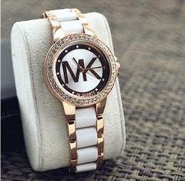 2018 nuevas letras de moda coreanas imitación de cerámica estudiantes femeninos pulsera de diamantes de imitación reloj de moda pulsera de cuarzo reloj de alto grado B desde fabricantes