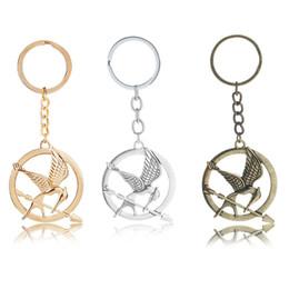 12 pz / lotto The Hunger Games Keychain Popolare Vintage Style Uccelli Portachiavi Portachiavi In Metallo Portachiavi per uomini donne regalo gioielli da