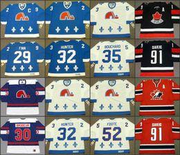 2020 maglia hockey 52 Quebec Nordiques 29 STEVEN FINN 30 RICHARD BRODEUR 32 DALE HUNTER 35 DAN BOUCHARD 52 ADAM FOOTE CCM NHL Vintage Away Hockey Jersey cucito sconti maglia hockey 52