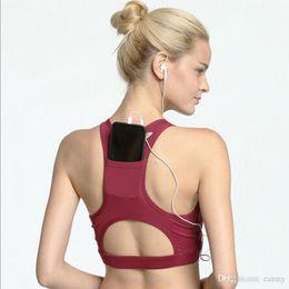 0cd525c1092b6 Wholesale- Compression Padded Sports Bra With Phone Case Design Racerback  Yoga Sportswear Elastic Bra Push Up Bra Execution Sports Gym Top