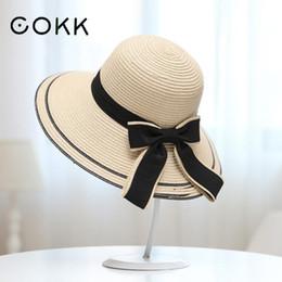 COKK Sun Hat Big Black Bow Cappelli estivi per le donne Pieghevole Spiaggia  di paglia Panama Cappello visiera a tesa larga Femme Femmina Nuovo  D18103006 ... b1ee365d4261