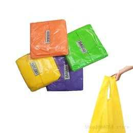 Eco Friendly Riutilizzabile Nylon portatile pieghevole shopping bag caramelle miste lavabili di grandi dimensioni Storage detriti maniglia di colore casuale da sacchetto della borsa di plastica fornitori