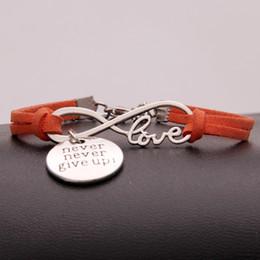 confezione regalo arancione Sconti New Fashion Infinity Love Never Never Give Up Bracciali Braccialetti per le donne Uomini Charm Orange Leather Rope catena Wrap metallo maschile gioielli regali