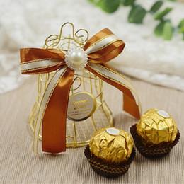 faveurs d'oiseaux Promotion Nouvelle boîte de faveur de mariage européenne créative boîtes d'or matel romantique en fer forgé birdcage mariage boîte de bonbons boîte d'étain en gros faveurs de mariage