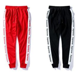 72608c4240a41 Envío gratis 2018 2color Nueva llegada pantalones hip hop Miedo de Dios  Moda ropa urbana pantalones de color rojo jogger pantalones al por mayor