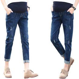 Verano nueve puntos agujero elástico suave pantalones de mezclilla de maternidad pies cuidado de las mujeres embarazadas vientre lápiz pantalones yuanjiaxin desde fabricantes