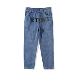 321f7128b5f 18ss Ripped Jeans Best Version Women Men Jeans trouser jumpsuit urban hip  hop punk motorcycle blue distressed urban jeans on sale