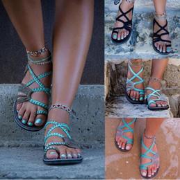 ANGUSH 2018 Verano Europeo / Americano Sand Beach Sandalias de fondo plano Mujeres Tallas grandes Chanclas Zapatillas Moda Ocho zapatos femeninos de color desde fabricantes