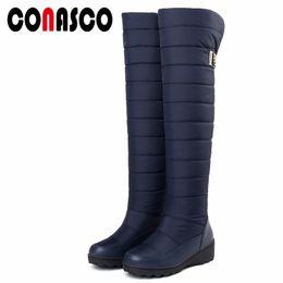 2020 botas de nieve abajo de las mujeres CONASCO Plus size 34-44 New Snow Boots Women Warm Cotton Down Shoes Botas impermeables Plataforma de piel sobre la rodilla alta rebajas botas de nieve abajo de las mujeres