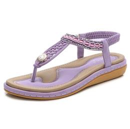Argentina Nueva y cómoda sandalias planas para mujer Zapatos de verano de gran tamaño Mujer Bohemia Flores Rhinestone Beach Ladies Shoes Suministro