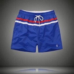 Nuevo verano hombres de la playa pantalones cortos de color sólido de algodón casual sueltos pantalones de cintura elástica Traje de baño Bermudas Hombre 88Letter Surf Life Men Swim ropa desde fabricantes