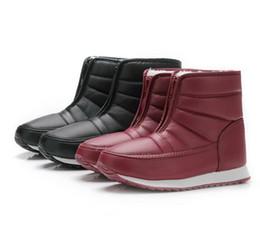 Argentina Cálido de gran tamaño bajo tubo nieve botas hombres tubo corto de la piel una absorción de choque antideslizante botas de algodón de goma inferior Suministro