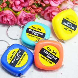 mini llaveros Rebajas Cinta métrica mini cinta portátil de plástico de 1 m con llaveros Reglas de tracción Herramientas de calibrado colores aleatorios para estudiantes