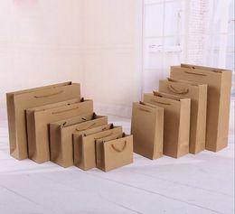 Canada 2018 10 tailles stock et personnalisé papier cadeau sac sac en papier kraft brun avec poignées en gros cheap kraft brown paper gift bags Offre