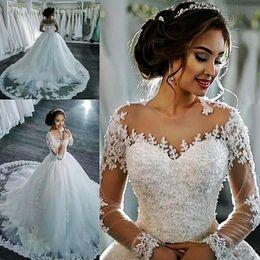 Vestidos de casamento apliques de renda on-line-Incrível Sheer Neck vestidos de casamento barato Lace Applique Beads ilusão mangas compridas vestidos de noiva longo trem botões Plus Size Wedding Dress