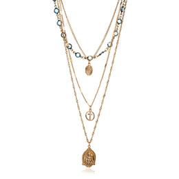 Ciondolo croce cristallo blu online-Girocolli di cristallo blu vintage collane Moda multi strato Gesù croce collana pendente dichiarazione gioielli bohemien per le donne