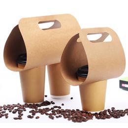 200pcs Eco Friendly Kraft Paper Cup Holder Bevande usa e getta Caffè Tè e latte Tazza Base Maniglia Titolari Takeaway Drink Packaging da usa e getta bento all'ingrosso fornitori