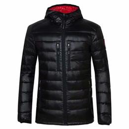 63303b846c5487 2018 Nouveau Canadian Fashion Sports Brand Man 100% duvet d oie mince de  haute qualité veste chaude à capuche coton occasionnel manteau tenue  livraison ...