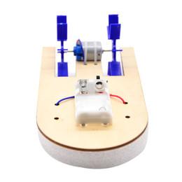 Canada double palette électrique bateau Minglun vedette rapide technologie de puzzle primaire et secondaire petite maquette de navire de production expérience scientifique populaire cheap electric speedboat Offre