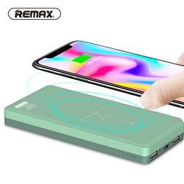 2019 cargador inalámbrico de puerto REMAX QI 5W Pad Cargador inalámbrico Power Bank 10000mah Portátil Batería externa 2 Puertos USB Powerbank para Iphone X 8 / Samsung S8 cargador inalámbrico de puerto baratos