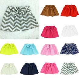92f793eab49 2019 motifs de jupes pour bébés Bébé filles mignonnes en coton jupe arc  jolies couleurs mignonnes