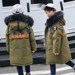 Kinder s lange daunen online-Kinder-Daunenjacke in der langen Han-Ausgabe des Jungen von 2018 verärgert die neuen Kinder, die einen Mantel tragen
