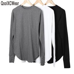 Qoolxcwear New Thumb Hole Polsini Manica lunga Tyga Swag Style Man High Low  Side Split Hip Hop Maglietta T -Shirt Uomo Abbigliamento a prezzi  accessibili ... e7f17696bf2