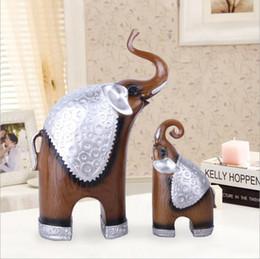 Estatuetas de elefante Estátua de Resina Decoração Acessórios Sala de TV Armário Animal Doméstico Casal Artesanato Decoração Lembranças Artesanato cheap resin animals figurines de Fornecedores de figurinhas de animais de resina
