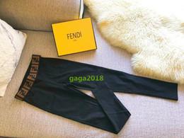 Cajas de lápices para niñas online-Las mujeres de gama alta estiran los pantalones Gym Yoga Leggings Medias Jeggings más calientes de las mujeres leggings negros marca de lujo lápiz delgado pantalones caja de regalo