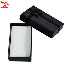 Archi di confezione regalo online-Contenitore di imballaggio stabilito dell'anello della collana del pendente del contenitore di gioielli di carta nero all'ingrosso 120pcs Contenitore di regalo dell'orecchino dell'arco di seta con la spugna 5 * 8 * 2,5 cm
