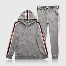Kit en marcha online-Diseñador Mens chándal carta de lujo trajes casuales sudaderas con capucha + pantalones primavera otoño cremallera Kits deportes correr chándal