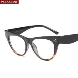 Peekaboo clear cat eye glasses monturas para mujer diseñador de la marca  sexy 2018 accesorios para anteojos montura mujeres cat eye black barato  mujeres ... f7a52ee3f55f
