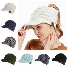 Wholesale crochet beanies hats - CC Ponytail Hats 12 Colors Knitted Baseball Beanie Warm Caps Crochet Hat Messy High Bun Cap OOA5283