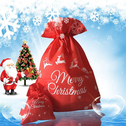 Bolsa de tela con cordón online-Bolsa de almacenamiento de la bolsa de regalo de navidad para niños Dulces de boda rojos Bolsas con cordón Tela no tejida de alto grado 1 8bm Ww