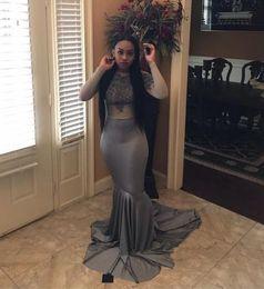 2018 Nuevos vestidos de fiesta de sirena de manga larga gris Barrida de encaje Apliques Abalorio Ilusión Vestido de noche de niña negra formal Vestidos de fiesta desde fabricantes