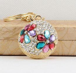 Wholesale Men Diamond Ring Designs - Beautiful design hollow spherical key ring with shining diamond metal key chain handbag fashion accessories car pendant nice gift multicolor