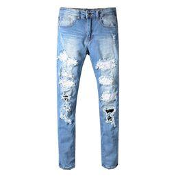 Pantalones de remache punk online-Al por mayor-Punk jeans remache de diseño pantalones Aquaman mens delgado motorista derecho flaco jeans hombres mujeres rasgadas hombres mujeres pantalones vaqueros